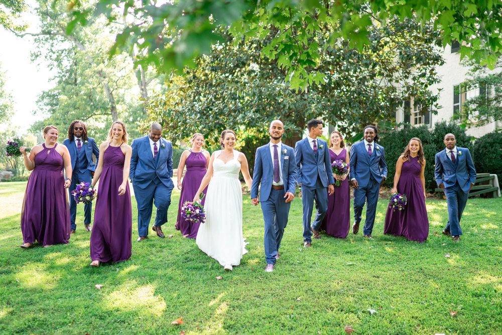 Bride and groom and bridal party walking photo at Rust Manor House