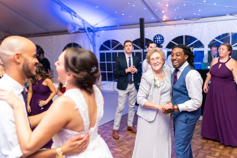 Guests dancing with bride and groom at Rust Manor House