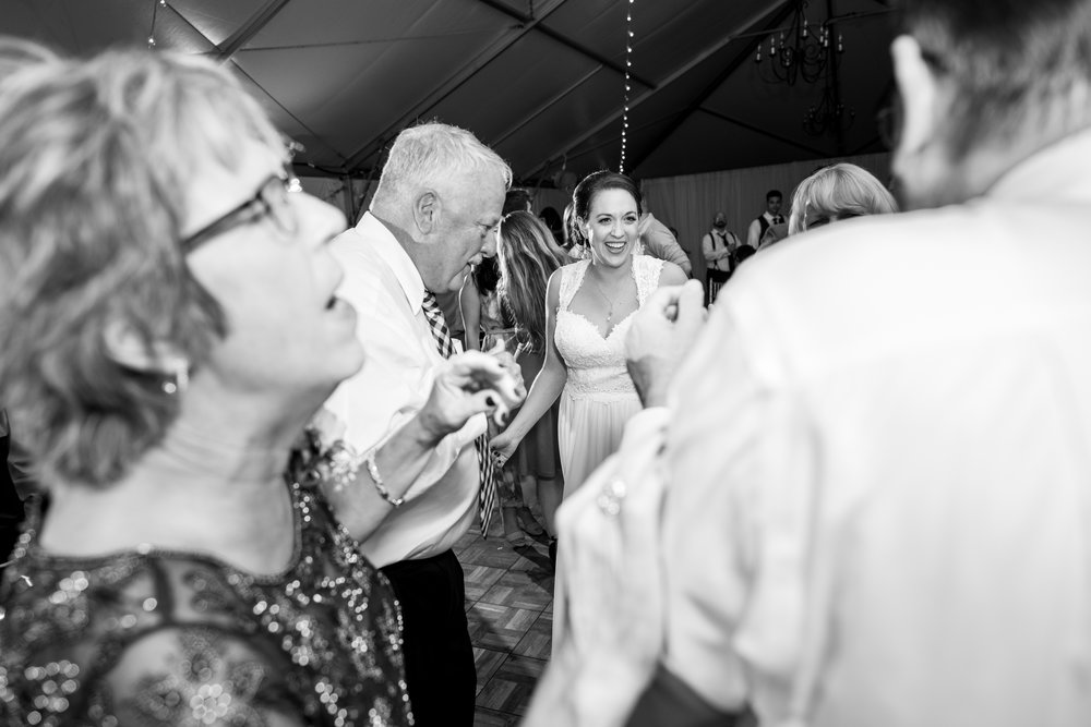 Bride dancing with parents and grandparents at Rust Manor House
