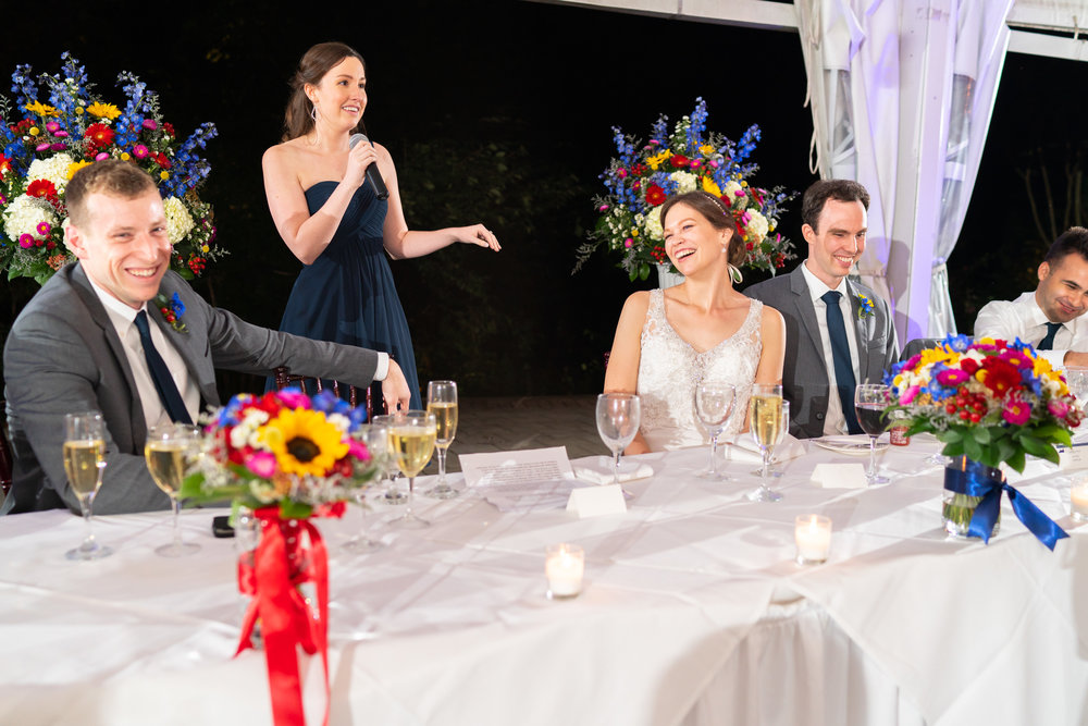 Maid of Honor giving a toast at wedding under tent Elkridge Furnace Inn reception photos