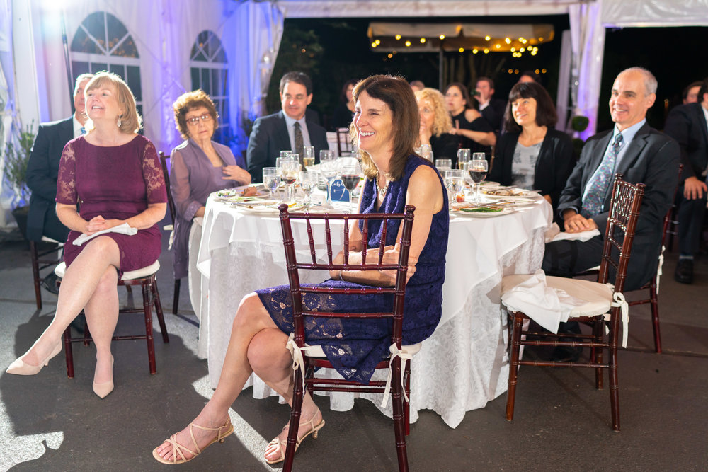 Parents listening to the toasts at wedding reception at Elkridge Furnace Inn