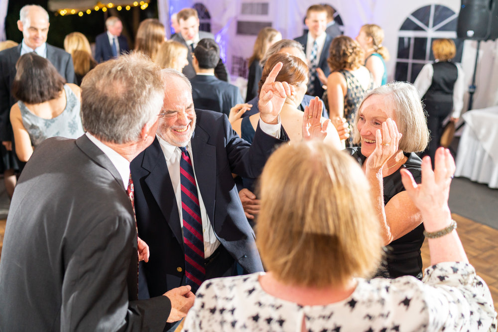 Family dancing during wedding reception at Elkridge Furnace Inn