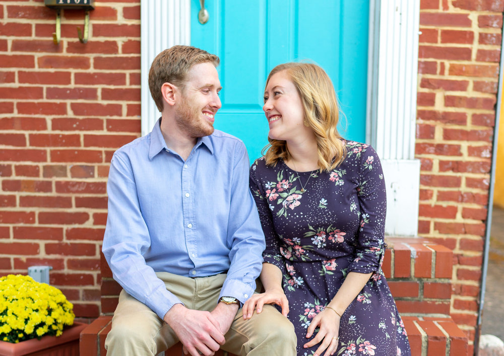 Baltimore Federal Hill engagement session in front of turquoise teal front door
