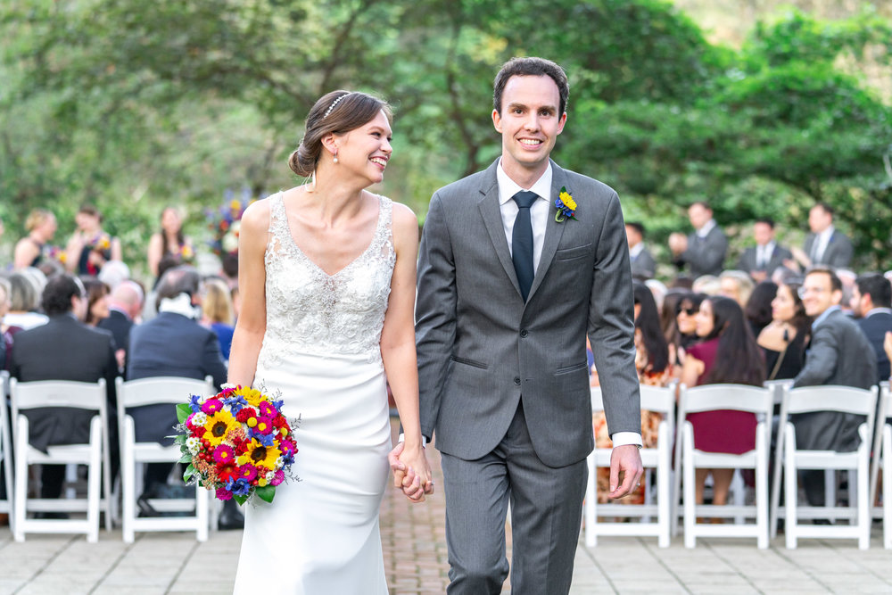 Bride and groom walking down the aisle at Elkridge Furnace Inn in Morilee Myka