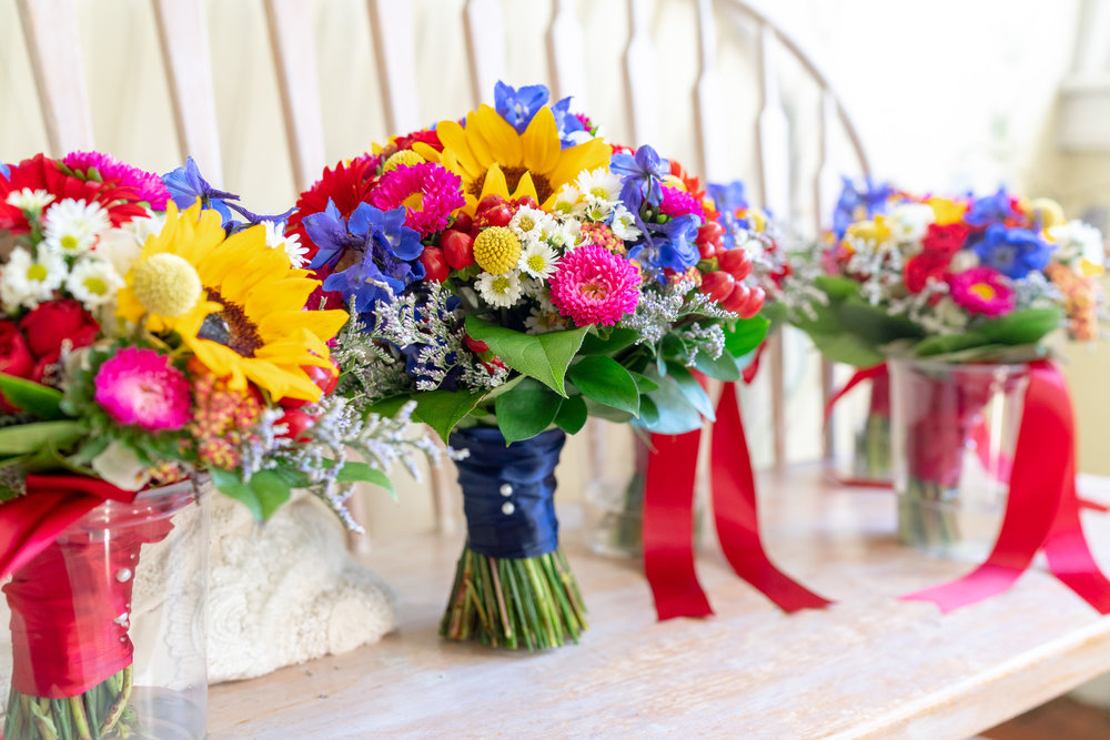 Extremely colorful bouquets by Blossom and Basket Boutique at Elkridge Furnace Inn wedding
