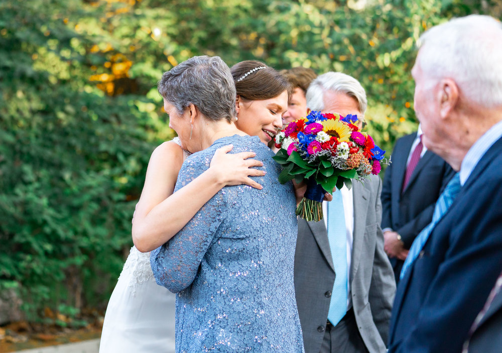 Bride and mom hugging before wedding ceremony at Elkridge Furnace Inn photos