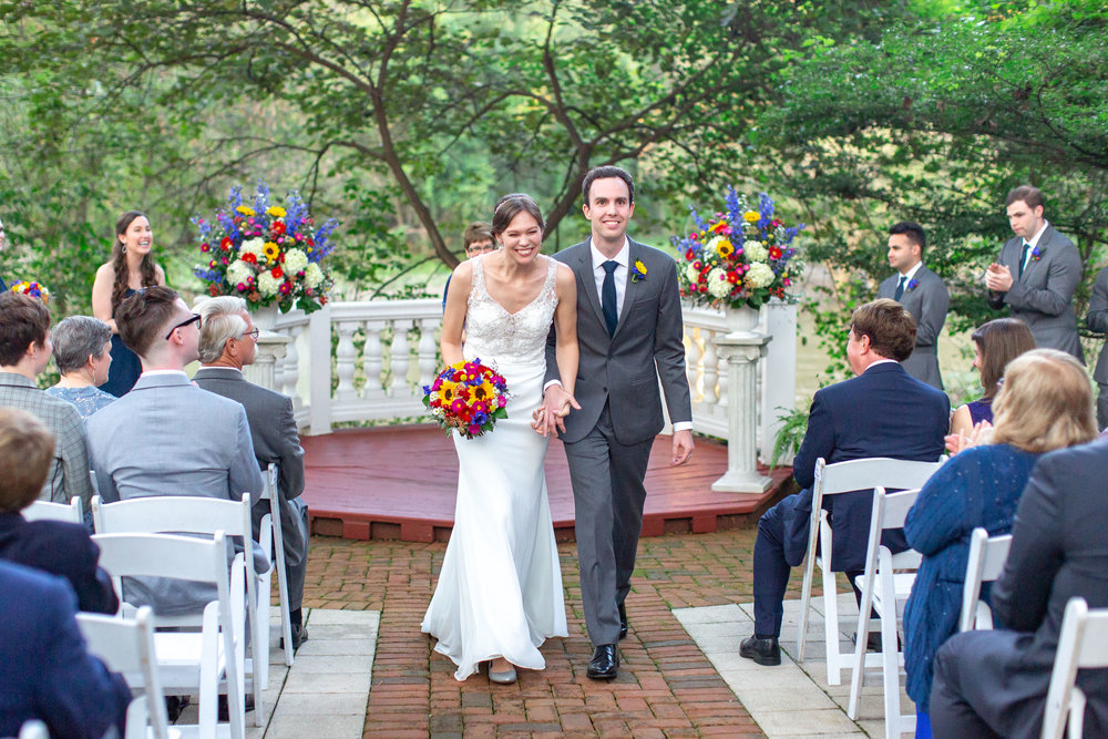 Bride and groom walking down the aisle after ceremony at Elkridge Furnace Inn