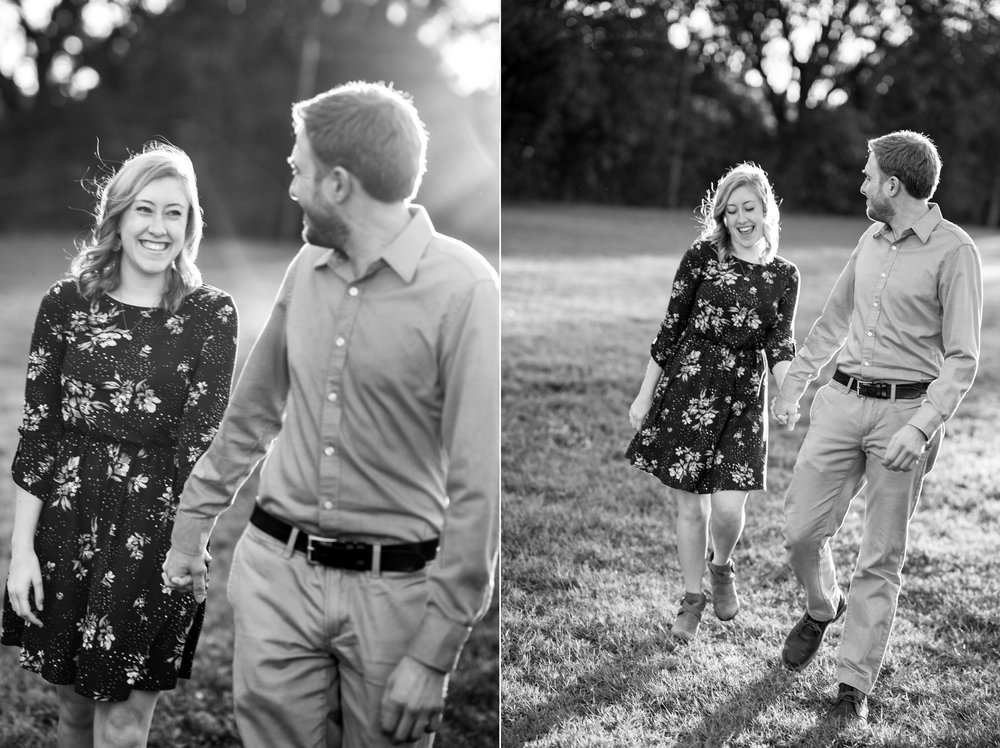 Walking across the lawn at sunset during engagement session at Federal Hill Park in Baltimore