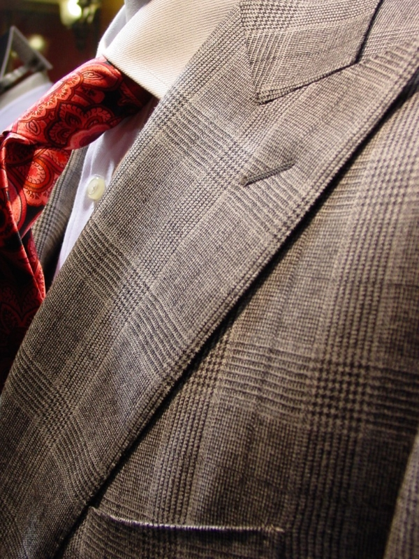 The peak lapel of a double breasted suit.