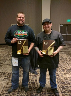 Robert Klemm, Chef at The Villa at Heaven City (right) and Brian Francis, co-owner of Mulligans Irish Pub and Grill display their new hardware. (Photo courtesy MKE Chili Bowl)