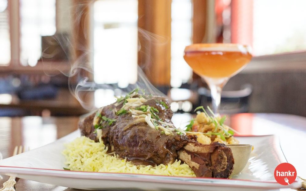 Strauss lamb shank braised with garlic, ginger, onion, cinnamon, cloves, cardamom, cumin and coriander. Served with rice and seasonal vegetables