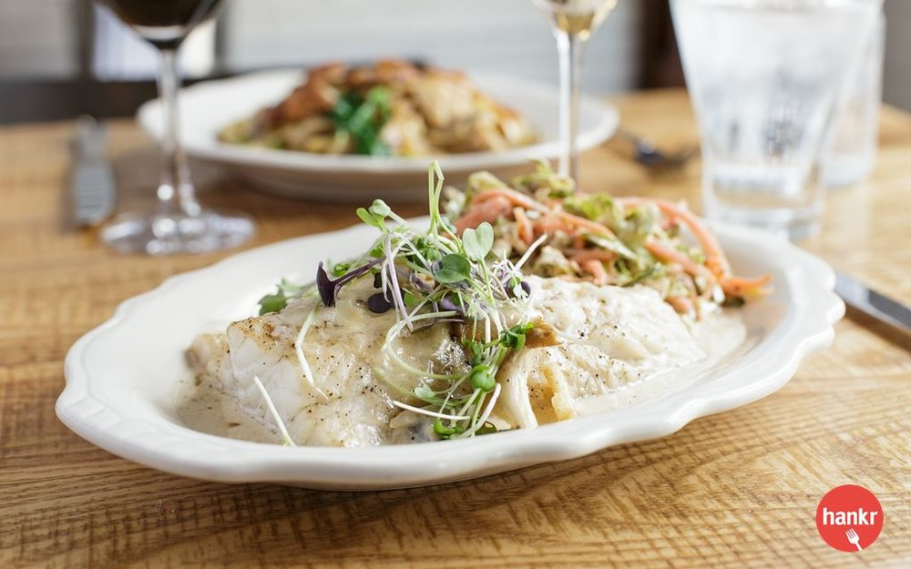 Walleye smothered in Sugar Bee Farm oyster mushroom and sherry cream sauce, with garlic crumbs, Montamoré cheese, and a Brussels sprout slaw.