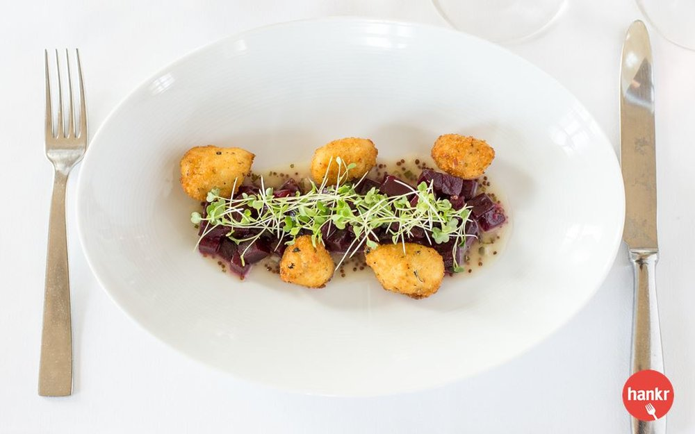 Marinated beets, fried goat cheese curds, baby arugula, chardonnay vinaigrette