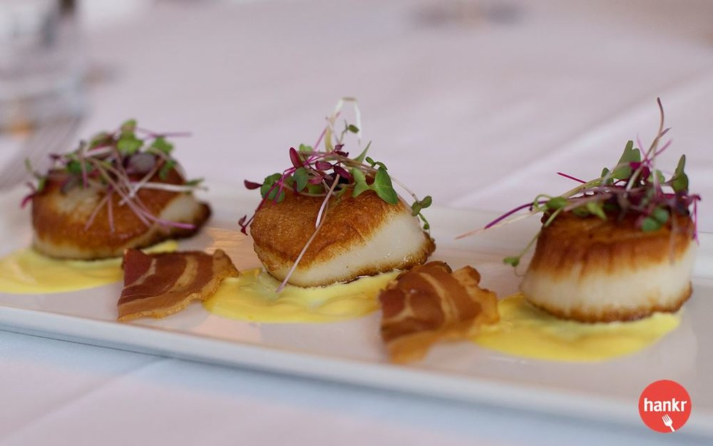 Three diver scallops, orange saffron sauce, pancetta crisp, micro herbs