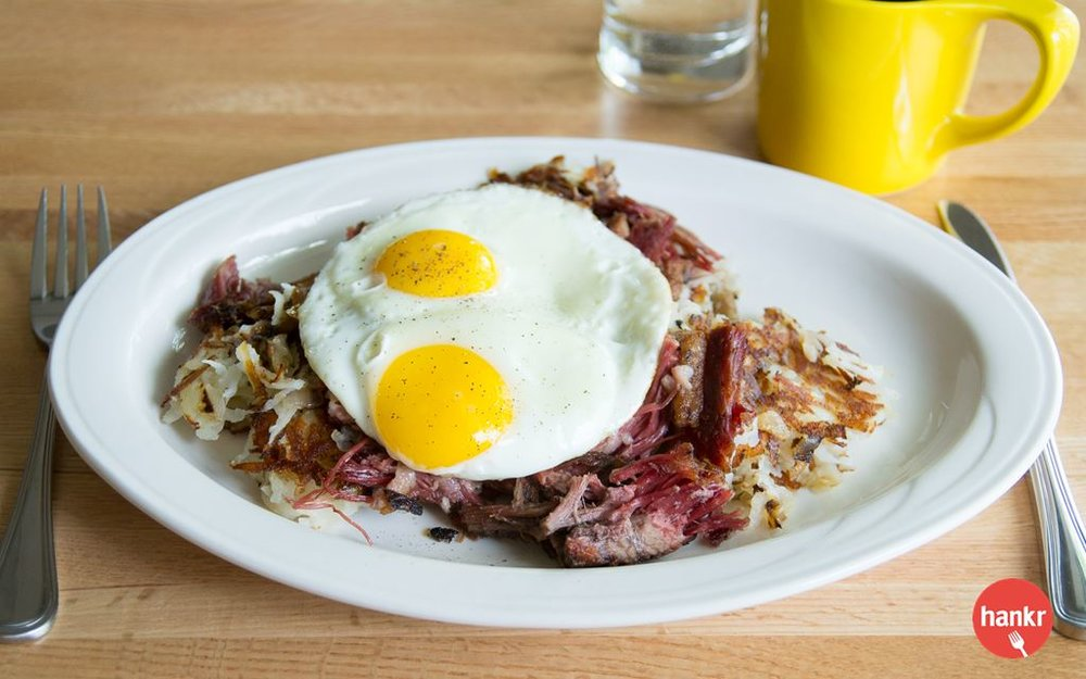 Corned beef brisket, hash browns, onions, sunny side up eggs