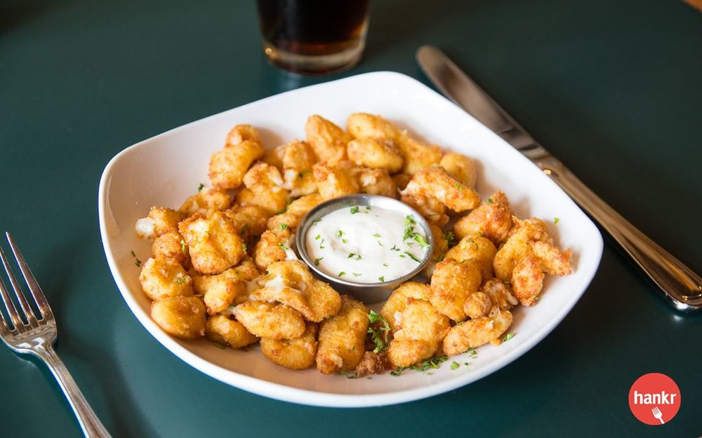 House-breaded Wisconsin white cheddar curds, served with ranch. Add sauce trio - cranberry, sage and hot aioli for $1.