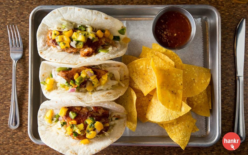 Chipotle-seasoned tilapia, chipotle sour cream, jalapeño vinegar slaw, and mango salsa. Served with tortilla chips and housemade salsa. Corn tortillas available upon request.