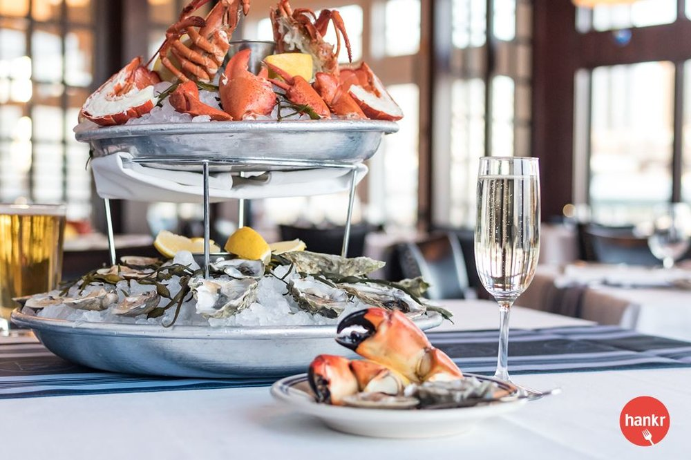 Seafood Tower. Featuring a selection of Oysters on the Half Shell, Clams on the Half Shell, Fresh Crab, Lobster, Shrimp, Salmon or Tuna Tartare (Prices and selections are seasonal)