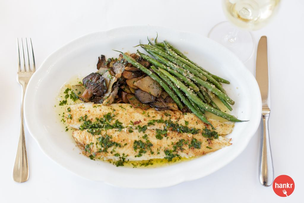 True Dover Sole sauteed with brown butter and fresh lemon. Served with French beans, sauteed potatoes and oyster mushrooms. Filleted tableside. A Lake Park Bistro Signature Item.