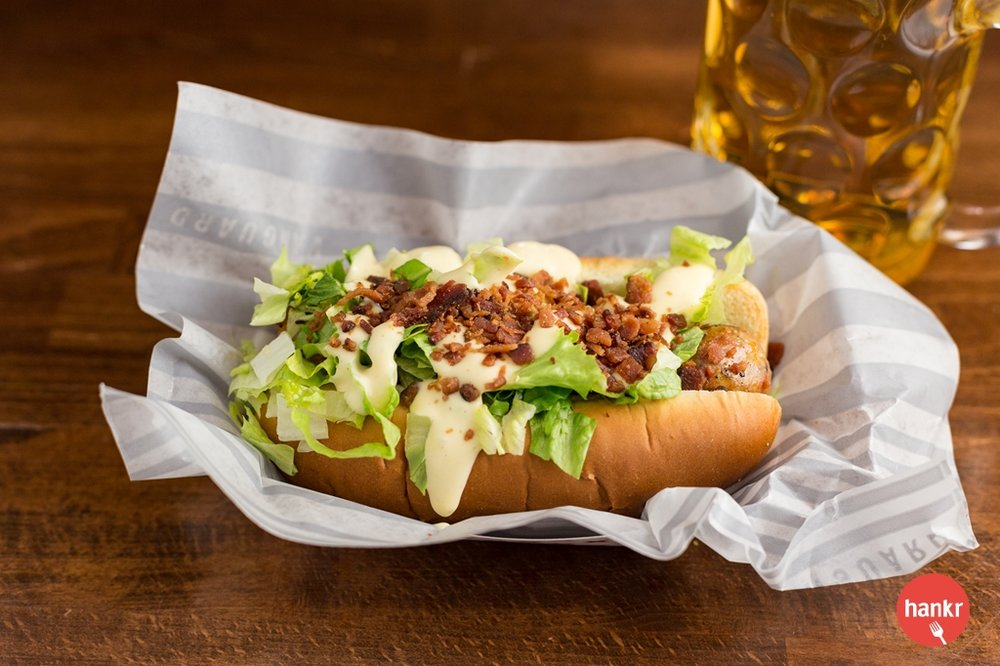 Duck + bacon sausage with shredded lettuce / hollandaise aioli / bacon. Served on a warm freshly baked roll.