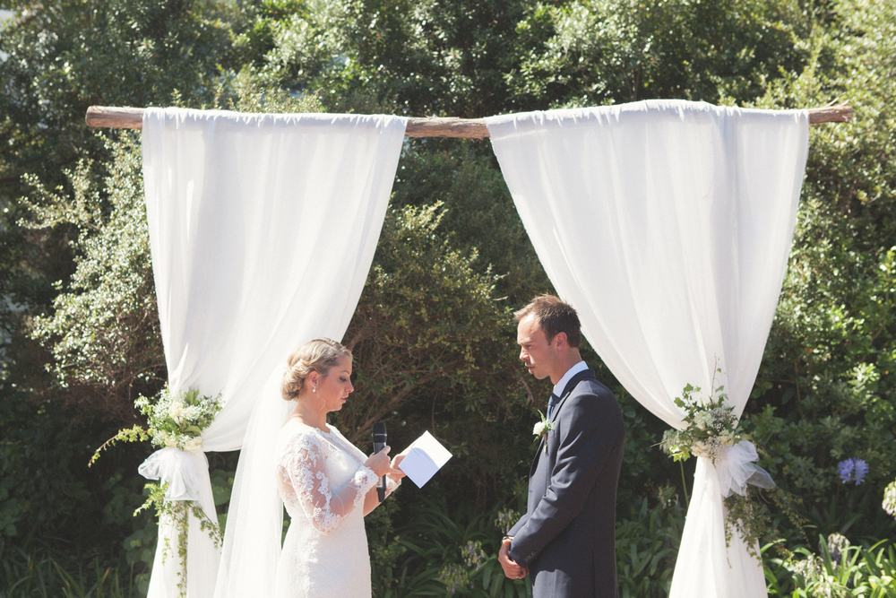 Bride and Groom exchanging their wedding vows in garden setting