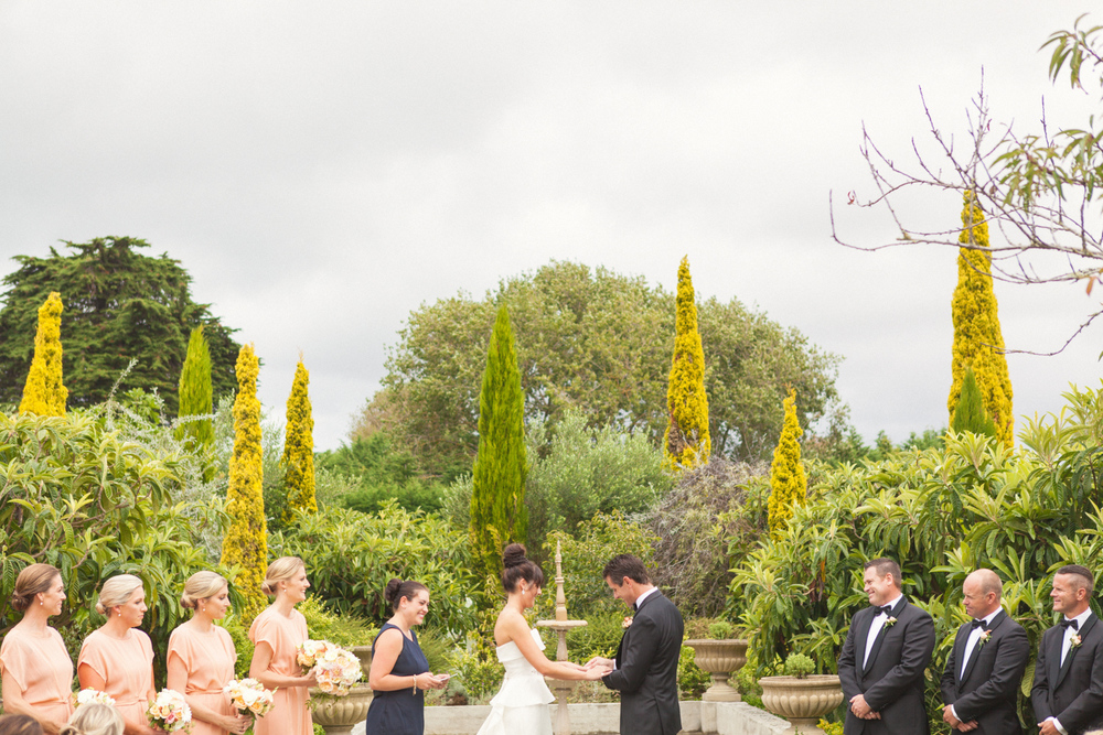 Bride and Groom exchanging wedding vows in garden wedding venue Wellington