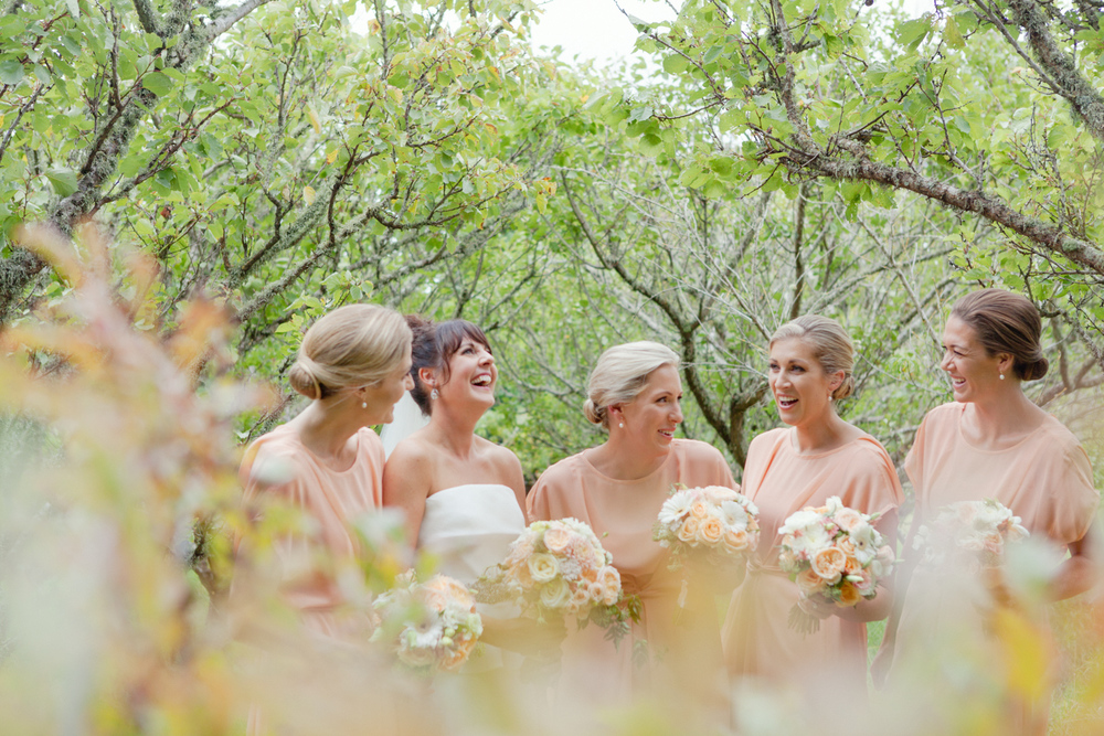 Bridesmaids laughing in wedding photos