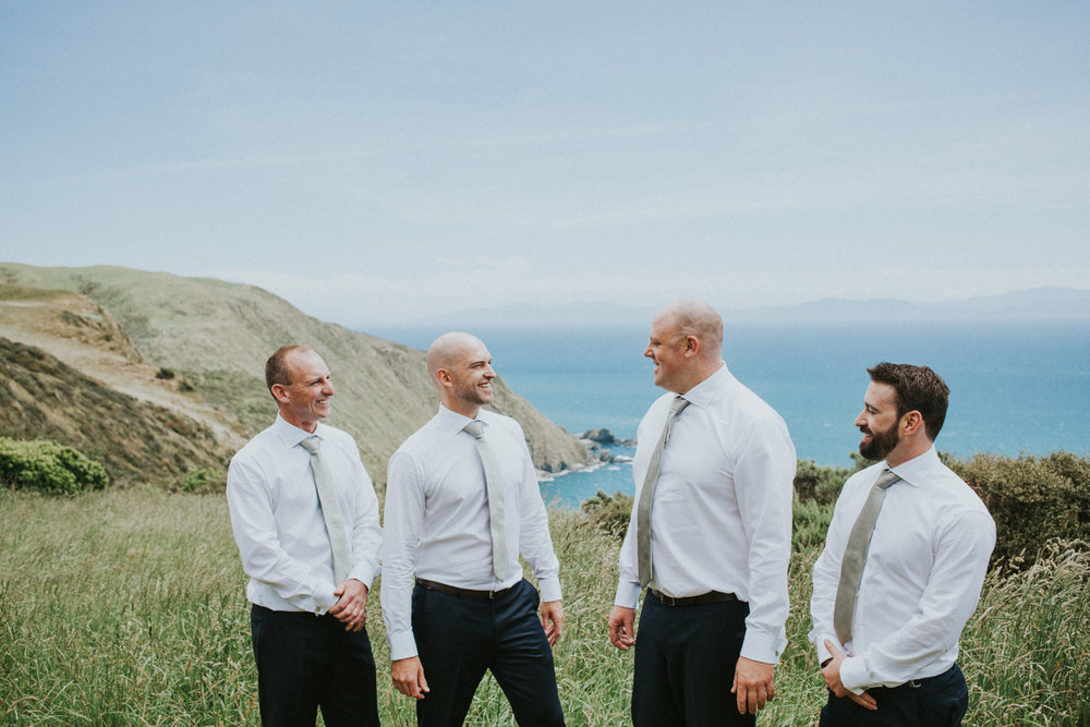 Groom and Groomsmen on hilltops at Boomrock