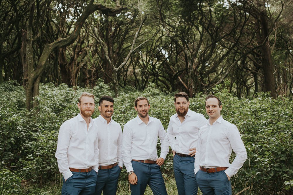 Groom and his groomsmen bridal party photos