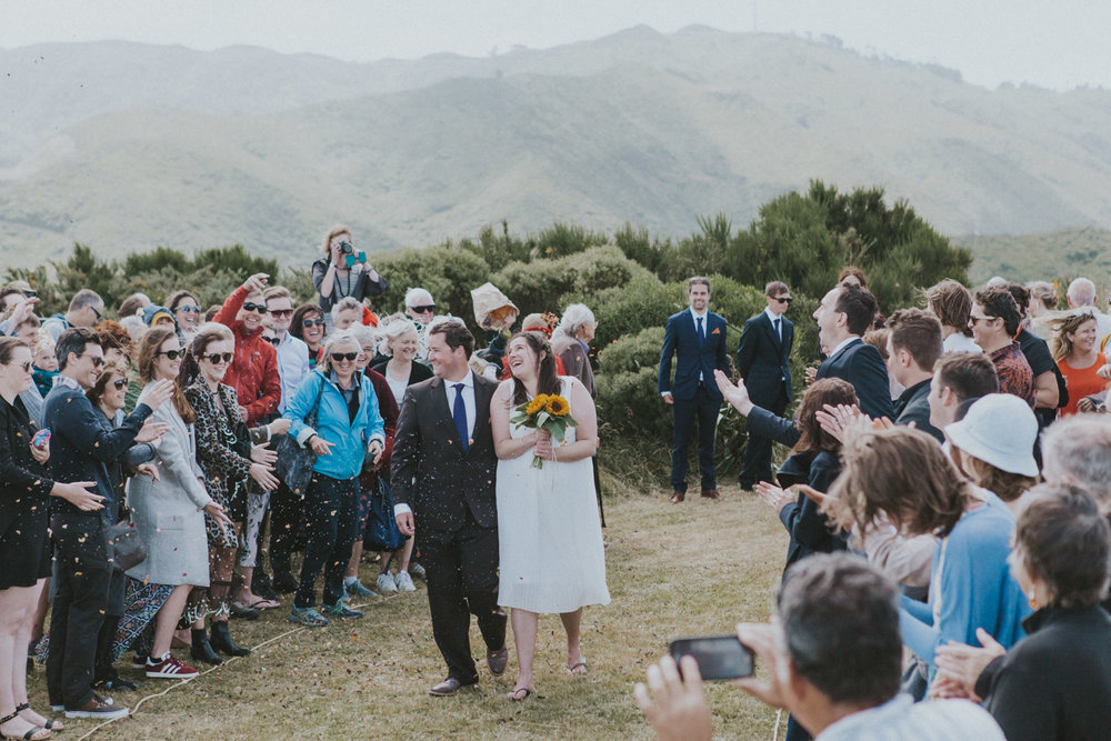 Groom walks his Bride down the wedding aisle during Wellington wedding