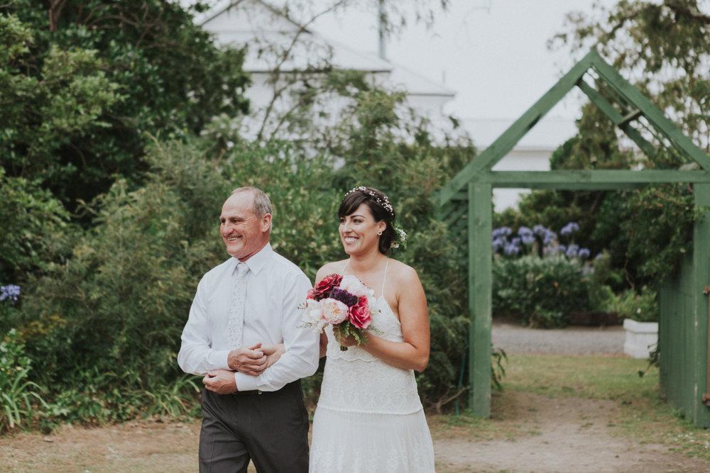 Father walking Bride down ceremony aisle at Tarureka Estate Wairarapa wedding venue