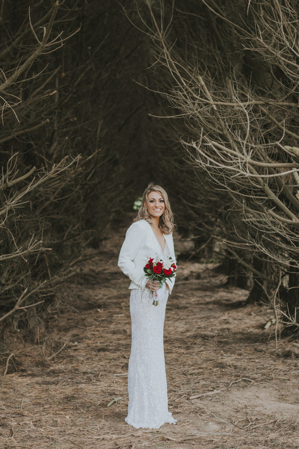Bride looking gorgeous amongst the pine trees