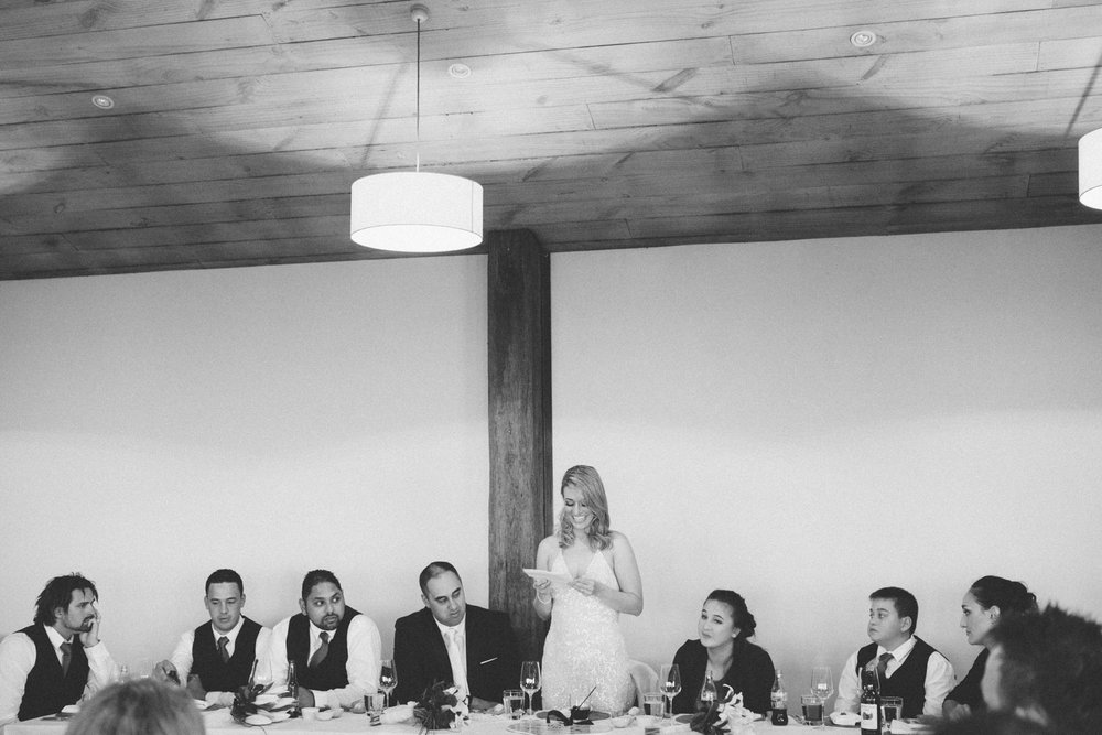 Bride giving her speech at wedding reception