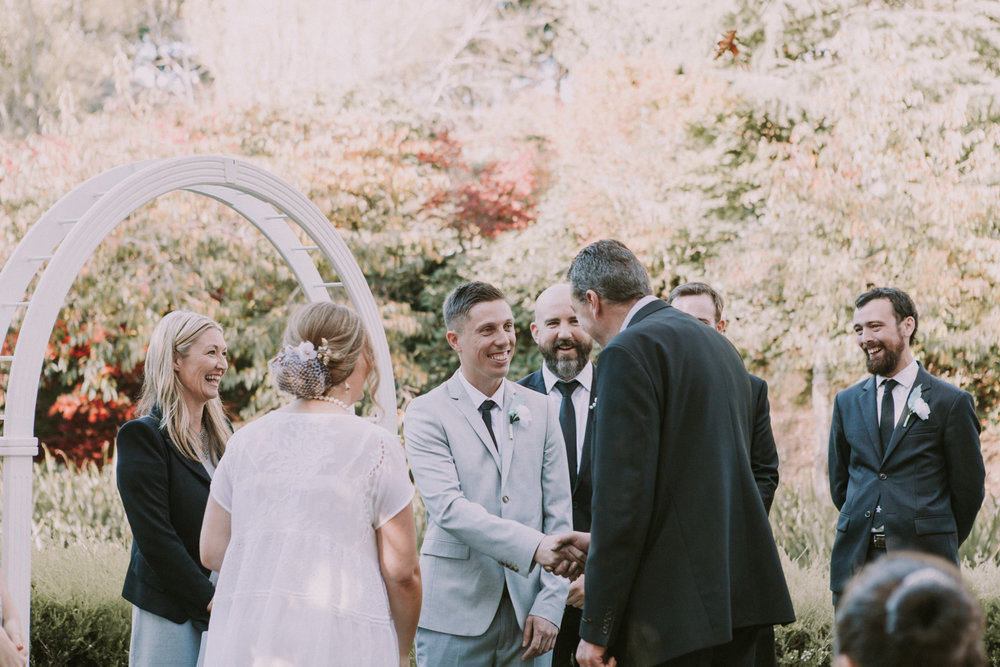 Groom shaking father's hand