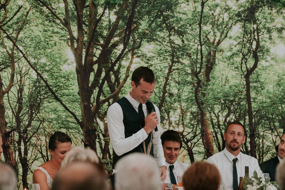Groom speaking at his wedding