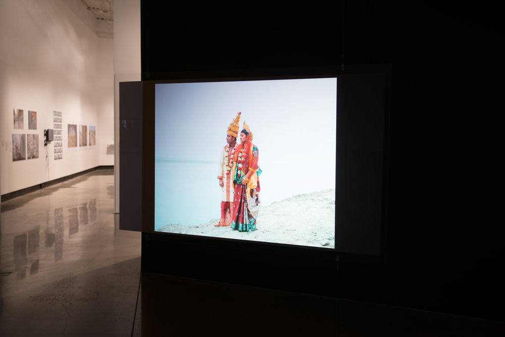 Ecological Justice: Installation view of Sarker Protick,  Of River and Lost Lands , video installation with music composed by the photojournalist. Photo courtesy Southeastern Center for Contemporary Art.