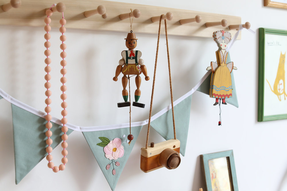 Handmade bunting from  Alba Makes Embroidery , Jewellery from  Halia Rose , Wooden camera from  Fanny and Alexander . Little wooden drawstring puppets I found in Hastings Old Town in one of the many antique shops.