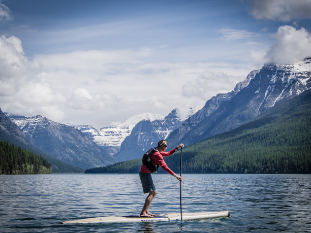 RIDGE Coach on SUP on Bowman Lake in Glacier National Park