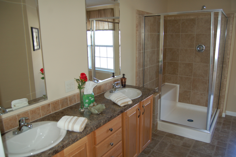 master bath wdouble vanity and ceramic tile shower natural oak cabinetry
