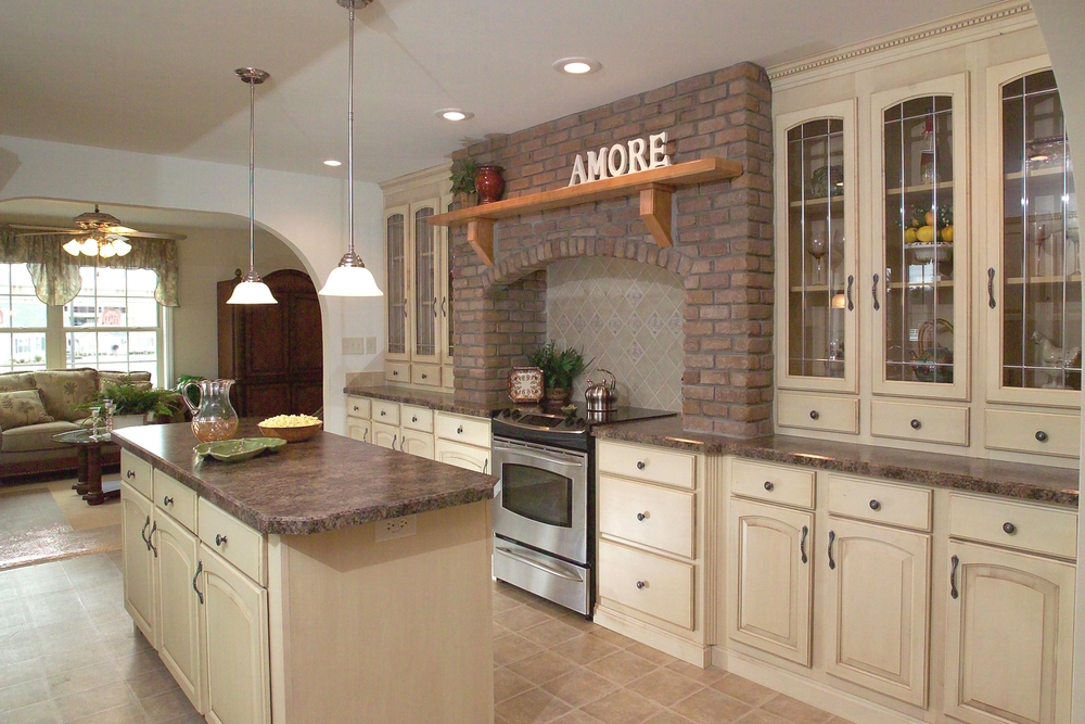 Hand-laid brick applied to a galley style Hearth kitchen, with a solid wood Honey Maple mantle