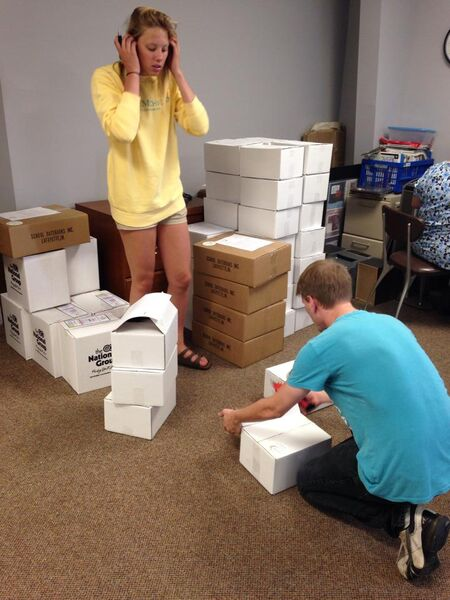 Getting our workouts in for the day...lifting and weighing all of the boxes!
