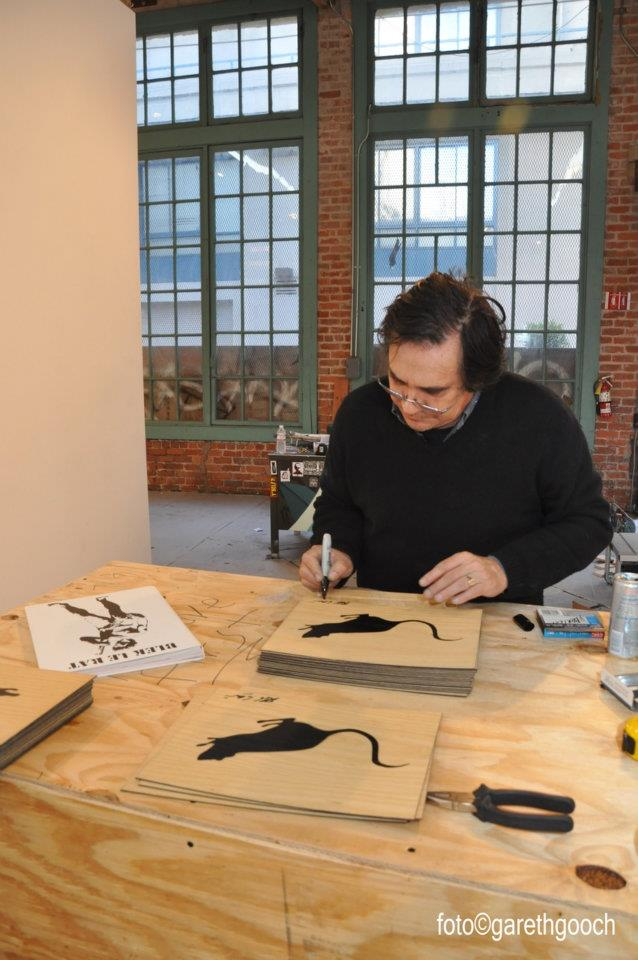 "Xavier Prou, a.k.a. Blek le Rat signs the original artwork included in the deluxe edition of ""Blek le Rat: 30 Year Anniversary Retrospective"""