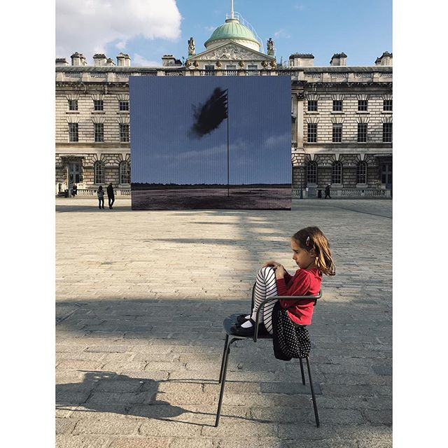 Earth Day installation at Somerset House: 'Western Flag' by John Gerrard, commissioned by Channel 4. The girl staring intently into space is not part of the commission, but makes a nice addition.