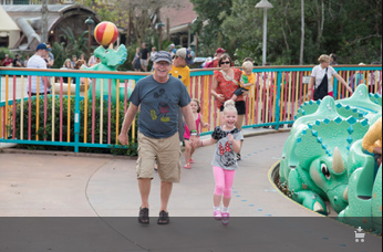 Paul sharing a joyous moment with our grand daughter Ava at Disney World.