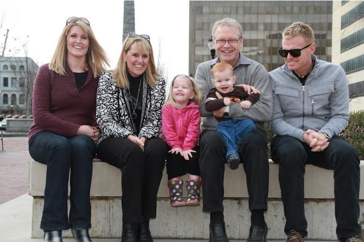 Happy times! Anna, Carol, Ava, Paul holding Tylan and Jay.