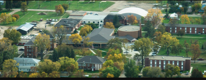 Aerial view of Trinity - the square building with the black roof is demolished and and new chapel will replace it!