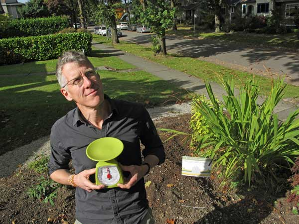Writer Jim Boothroyd with the kitchen scale his family uses to measure out their eco footprint impact, ounce-by-ounce.