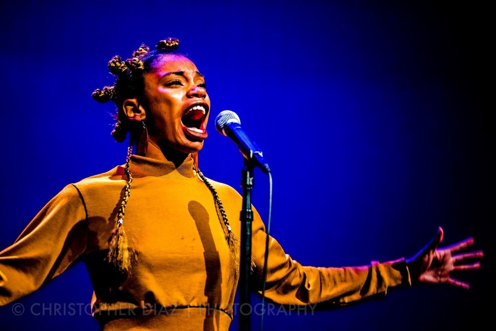 Jae Nichelle Promo Pic - hands out doing spoken word.jpg