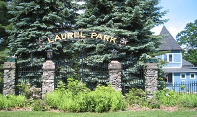 Laurel Park's front gates and Normal Hall, as seen from North King St.