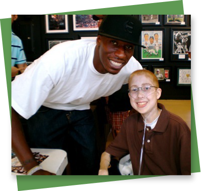 Richie with former Dallas Mavericks basketball player Josh Howard
